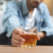Man reaching for alcoholic drink